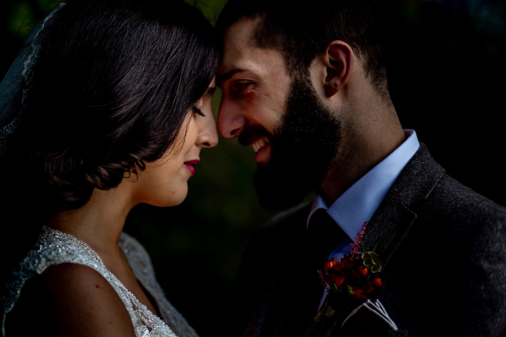 Bride and Groom having a moment together touching foreheads